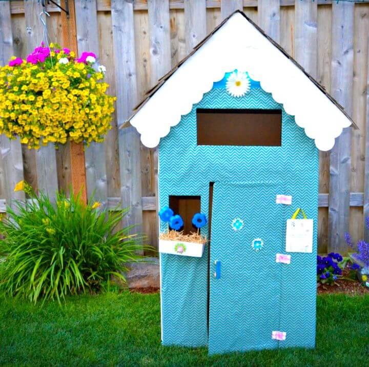 Cartón de reutilización de bricolaje para hacer una casa de juegos para sus hijos