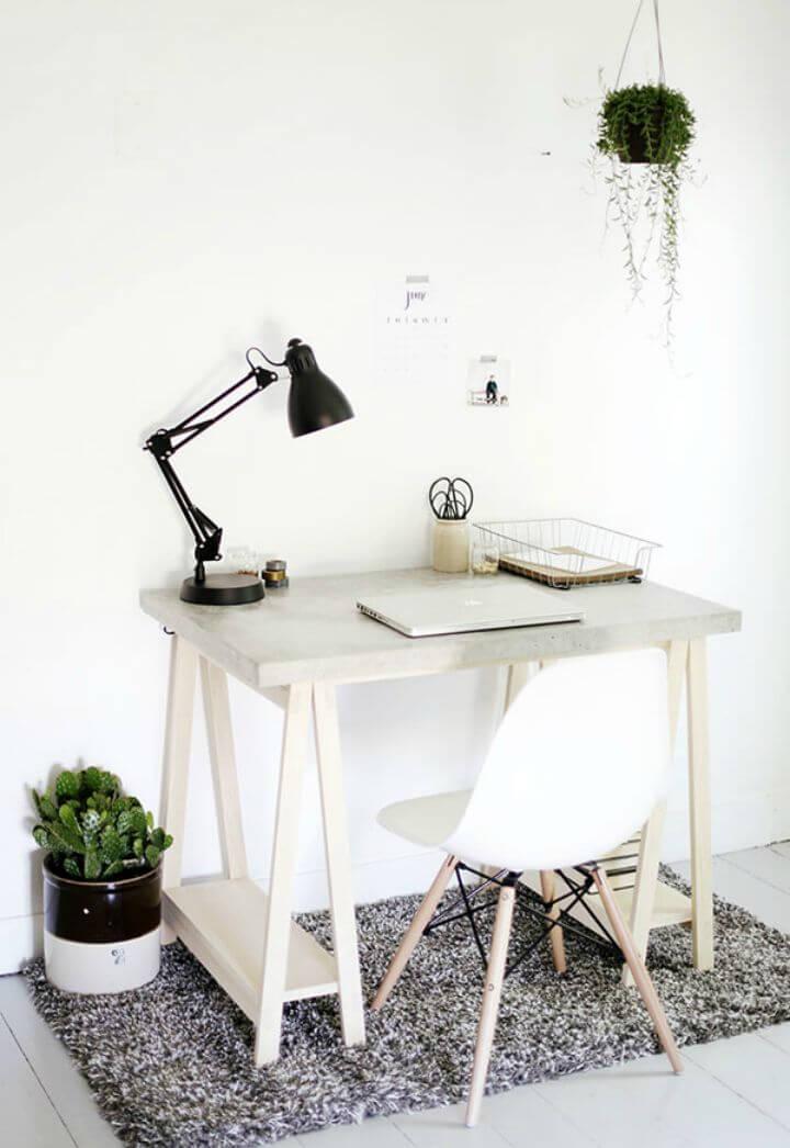 Escritorio de bricolaje con escritorio de hormigón y patas de madera