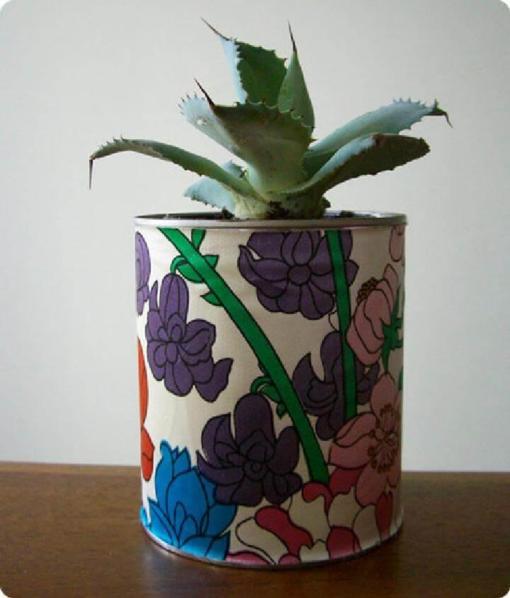 Plantador de latas de pintura envuelta en tela de bricolaje