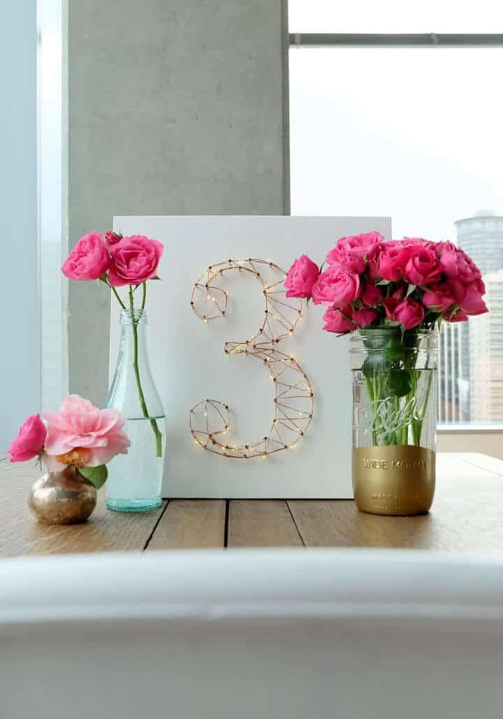 Número de mesa de boda de luz estrellada de bricolaje