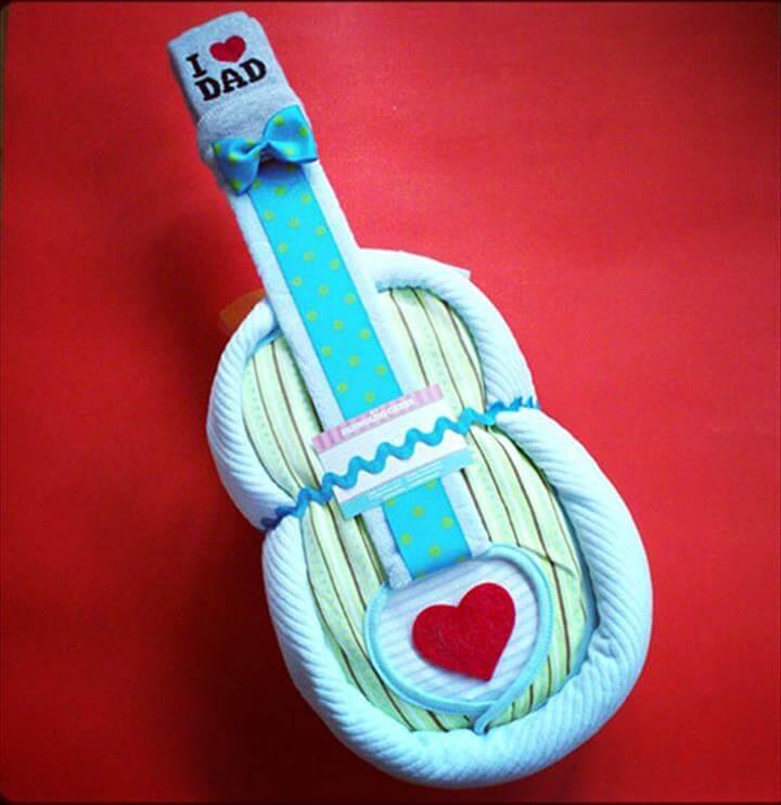 hermoso pastel de pañales de guitarra